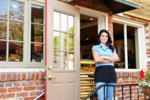 Business Locksmith Services - Woman outside of her Cafe